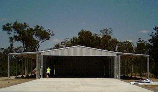 Airplain hangar with side awnings