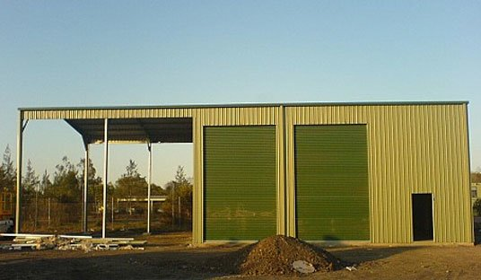 Extra tall industrial shed with awning.