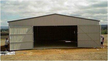 Airplane hangar with doors open