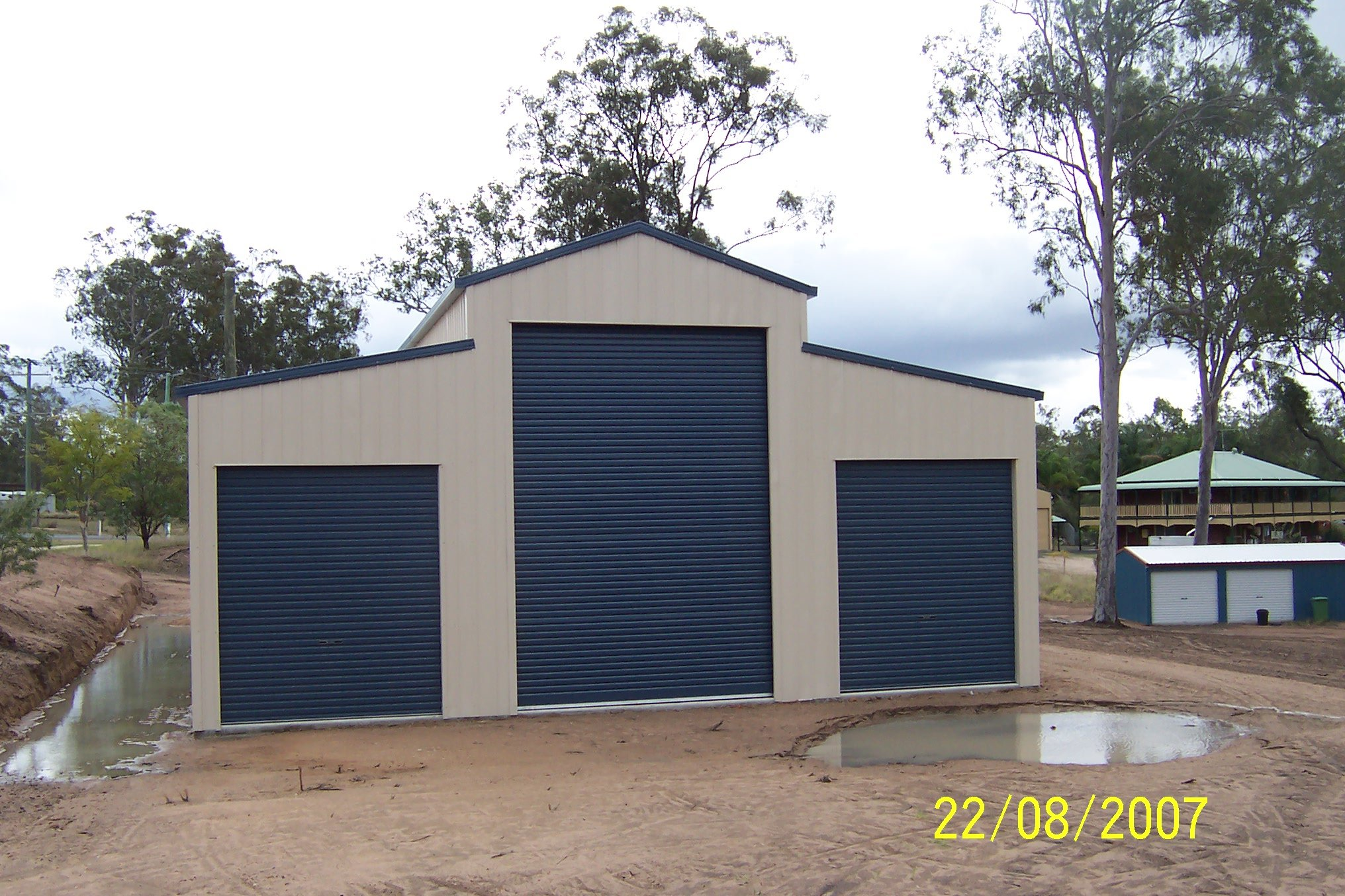 3 bay American style barn with 3 roller doors