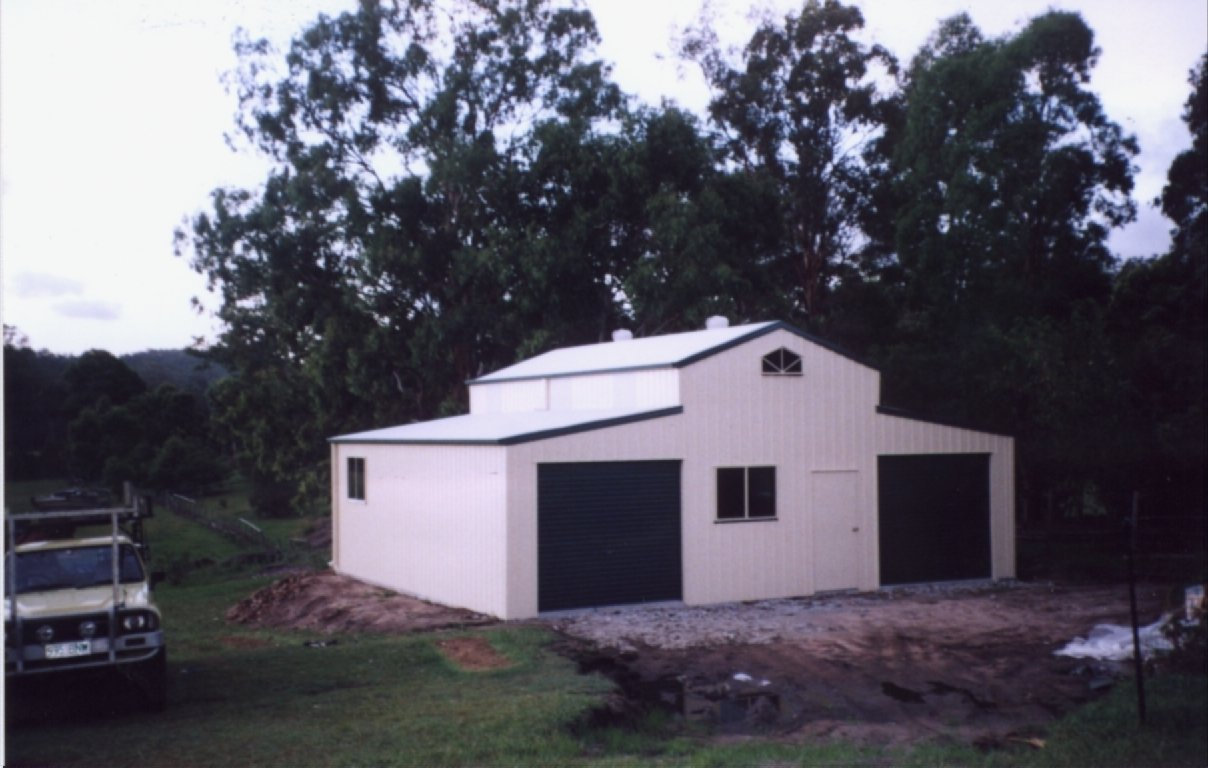 American style barn with 2 roller doors and windows