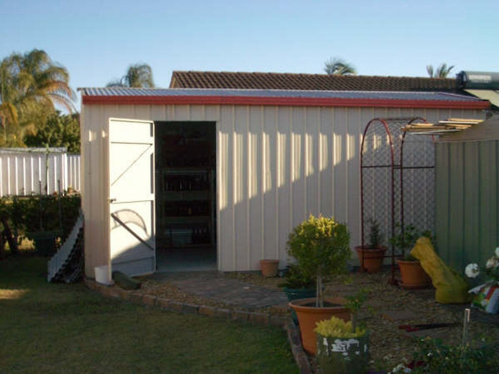 A Large Cream Garden Shed
